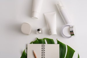 White cosmetic products and green le