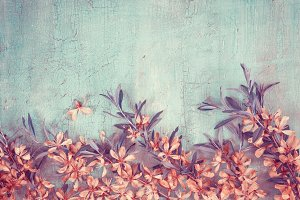 Border of flowering almonds on vintage background. Creative Toni