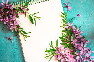Spring nature background with notepad and blooming almond