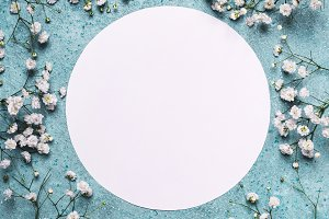 Blue spring floral background. Round frame from flowers hypsophyll