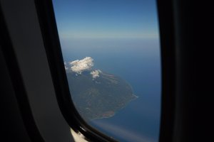 View from an airplane window on the ocean.