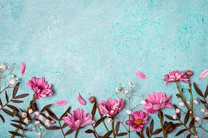 Spring Summer Creative nature background. Pink flowers border on vintage blue background