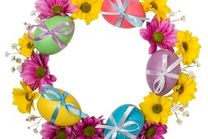Colorful wreath of Easter eggs and flowers isolated on white background