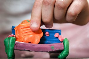 Hands of a small child of play plasticine