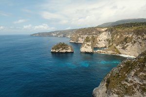 Cliffs, sea and waves at Nusa Penida, Bali, Indonesia