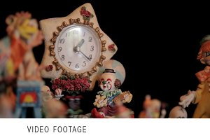Clown figurines and clock.