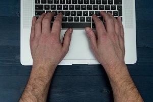 Man typing on laptop computer