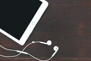 White iPad + music earphones