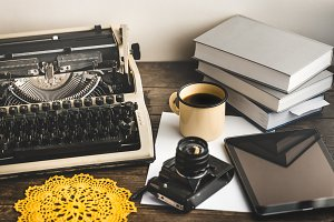 Workplace Of A Journalist, Writer, Blogger. Film Camera, Tablet, Books And Typewriter. Creative Studio Author Concept