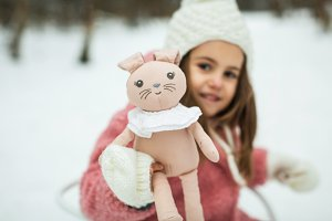 little girl with rabbit in winter