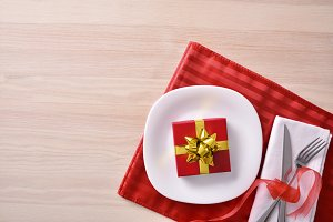 Red table decoration with gift top