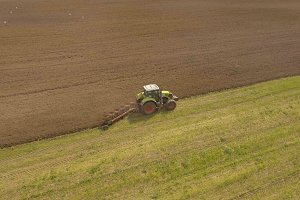 Tractor plowing a field.Aerial video.
