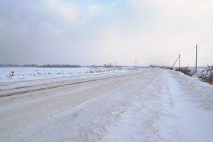 Winter landscape of fields and roads.