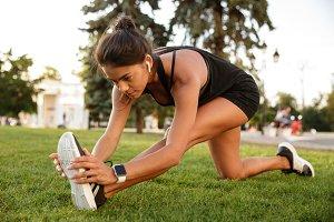 Portrait of a fitness woman in earphones