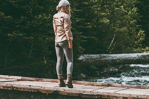 Woman alone standing on bridge
