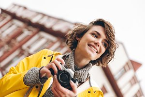 Concentrated young lady photographer
