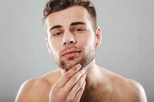 Close up beauty portrait of a young bearded man