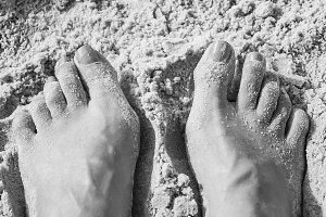Feet and Toes in the Sand on a Beach