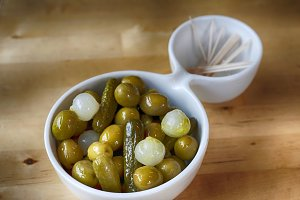 Bowl of olives, pickle and onion