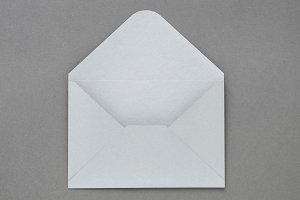 Gray envelope on dark background.