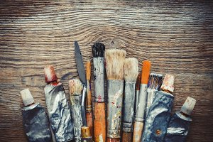 Brushes, paints and palette knifes.