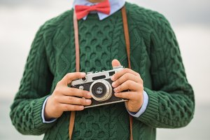 Kid hands holding vintage film camera