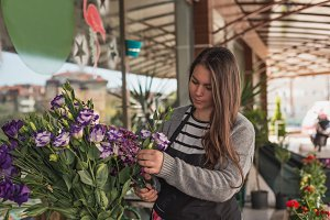 Small business concept. Female florist working in a flower shop