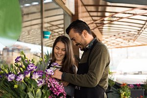 Florist couple working in a flower shop