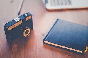 Office - Vintage camera on a desk