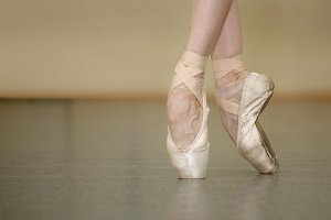 Slender ballerina feet in pointe sho