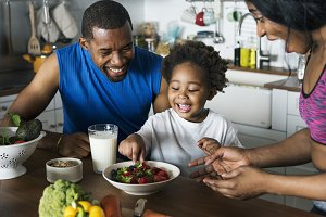 Black family eating healthy food