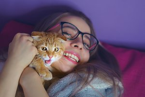 Girl hugging a kitten