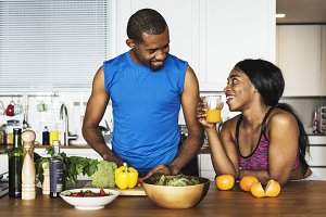 Black couple cooking healthy food in