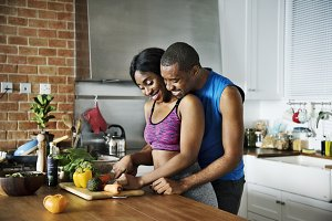 Black couple cooking healthy food