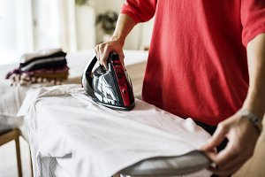 Woman ironing shirt