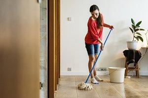 Caucasian woman doing house chores