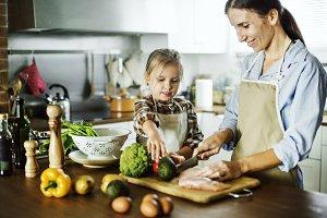 daughter help mother in kitchen work