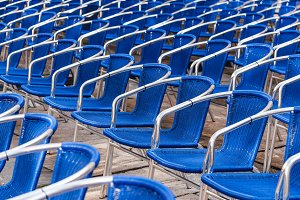 Blue chairs in outdoors event