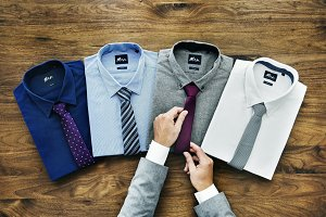 Businessman arranging formal wear