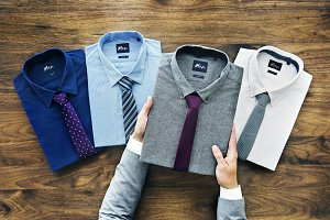 Businessman selecting shirt to wear