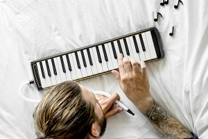 Man playing a melodian