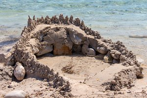 Sand castle built by kids