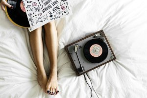 Woman listening to music with vinyl