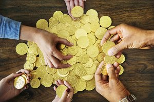 Wealthy people with golden coins