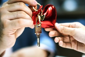 Man passing house key as a gift