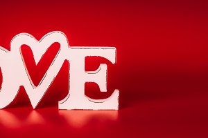 Word Love sign on red background