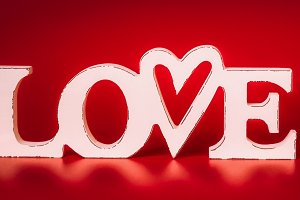 Love on red background