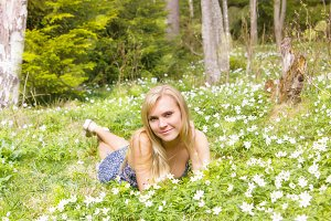 Woman having rest on flowers meadow