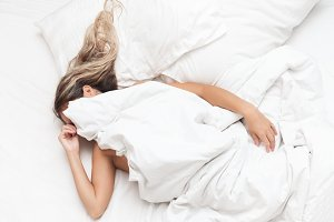 Woman in bed don't want wake up morn