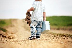 Toddler boy making first steps.